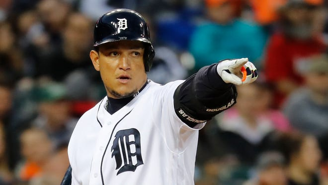 Tigers designated hitter Miguel Cabrera (24) points to first base for a call  in the fourth inning of the Tigers' 9-3 win Saturday at Comerica Park.