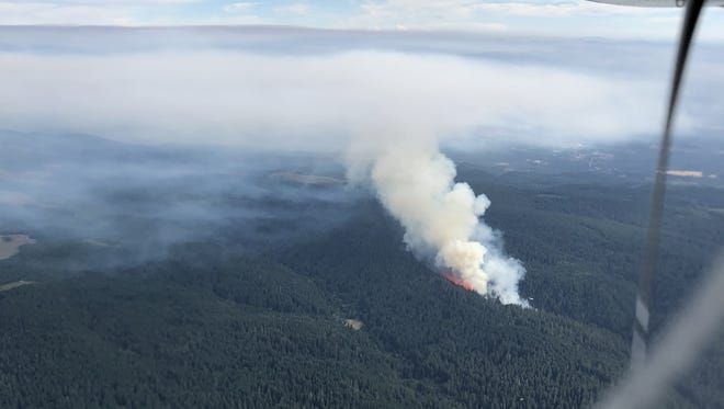 The fire burning at Silver Falls State Park from the sky on Friday.