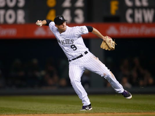 Colorado Rockies second baseman DJ LeMahieu throws to first base to put out San Diego Padres' Derek Norris in the sixth inning of a baseball game Saturday, April 9, 2016, in Denver. (AP Photo/David Zalubowski)