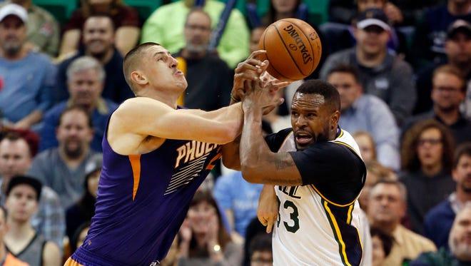 Dec 21, 2015, Salt Lake City: Phoenix Suns center Alex Len (21) and Utah Jazz forward Trevor Booker (33) battle for the ball in the second quarter.