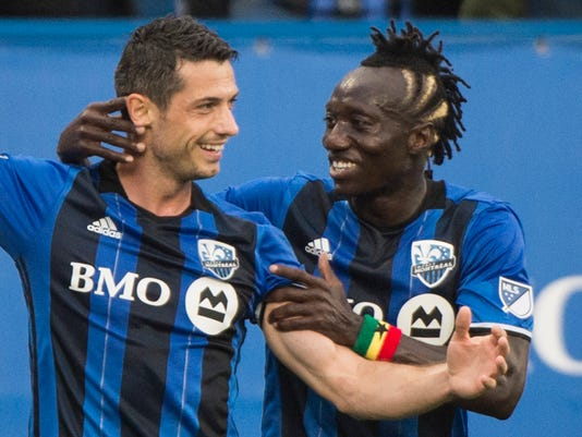 Montreal Impact's Blerim Dzemaili, left, celebrates with Dominic Oduro after scoring against D.C. United during the first half of an MLS soccer match Saturday, July 1, 2017, in Montreal. (Graham Hughes/The Canadian Press via AP)