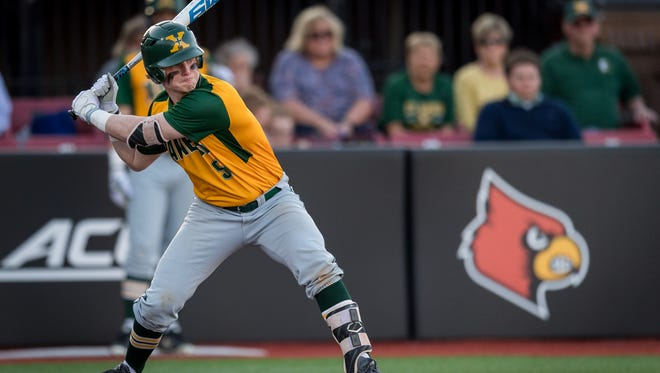 St. Xavier's Cam Scheler stands in to hit during the game played against Trinity on the campus of the University of Louisville in Louisville, Ky., Thursday, April 12, 2018.