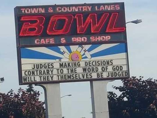 """The sign at Town & Country Lanes read """"Judges making decisions contrary to the word of God will they themselves be judged."""" The message has since been taken down."""