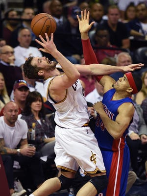 Kevin Love drives on Tobias Harris during the second quarter.