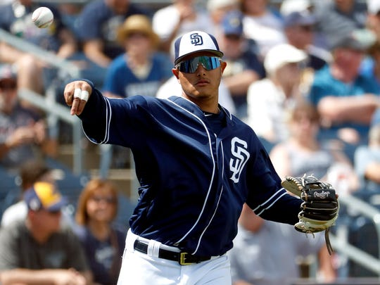 San Diego Padres' Manny Machado warms up prior to the team's spring training baseball game against the Milwaukee Brewers, Wednesday, March 20, 2019, in Peoria, Ariz. (AP Photo/Matt York)