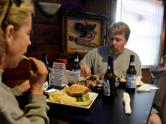 Patti Piety and her husband Andrew of North Codorus Township eat dinner in the bar area of Valley Tavern on Thursday, Aug. 14, in Seven Valleys. Valley Tavern has both a bar area, where smoking is permitted, and a restaurant.