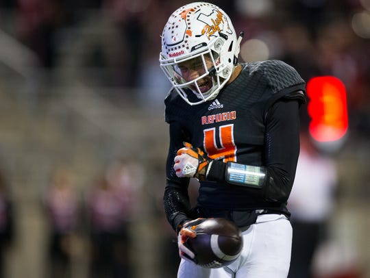 Refugio's Trent Ross reacts after score a touchdown