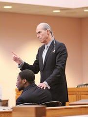 Defense attorney Bruce Harvey, right, makes his closing