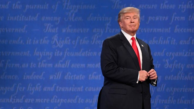 Republican presidential candidate Donald Trump looks at the audience at the conclusion of the third and final presidential debate at University of Nevada Las Vegas.
