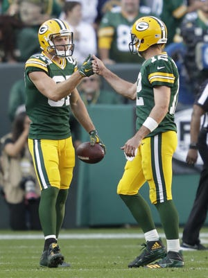Green Bay Packers receiver Jordy Nelson (87) celebrates his touchdown score with Aaron Rodgers (12) against the Seattle Seahawks on Sunday, Sept. 10, 2017, at Lambeau Field in Green Bay, Wis.