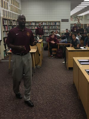 New Simi Valley High football coach Dameon Porter speaks to his players Friday at the school's library.