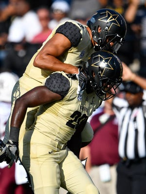 Vanderbilt safety LaDarius Wiley (5) leaps onto linebacker Oren Burks (20) after Burks made an interception against Alabama A&M during the second half of an NCAA football game at Vanderbilt Stadium in Nashville, Tenn., Saturday, Sept. 9, 2017.