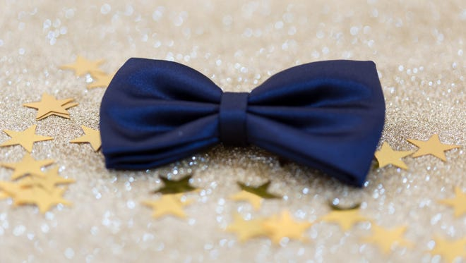 Bow Tie on a shiny gold background with stars shape