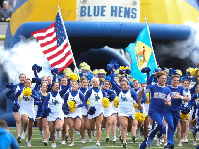 The Blue Hens are led onto the field by the cheer squad