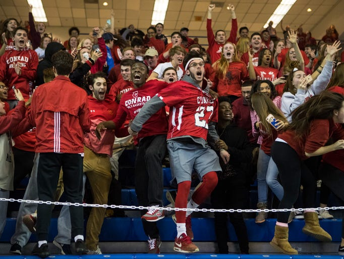The Conrad student section erupts after winning the