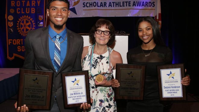 Joe Wilkins Jr. of North Fort Myers High and Destanni Henderson of Fort Myers High won the Top Athlete Scholarships of $5,000 each at the Rotary South Scholar Athlete banquet. They are with guest speaker and 5-time Olympic gold medal speed skater Bonnie Blair.