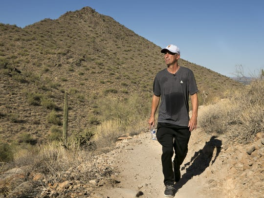 ASU head basketball coach Bobby Hurley hikes in the