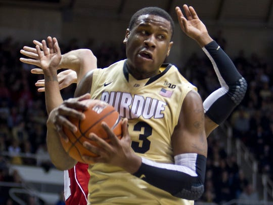 Purdue's Jay Simpson comes down with a rebound during their game against Wisconsin Saturday, January 25, 2014, at Mackey Arena in West Lafayette. Purdue lost 72-58.