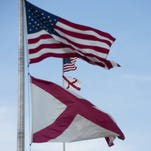 The American Flag and Alabama State flag fly on top of the Alabama Capitol building in Montgomery, Ala., on Monday, June 22, 2015.