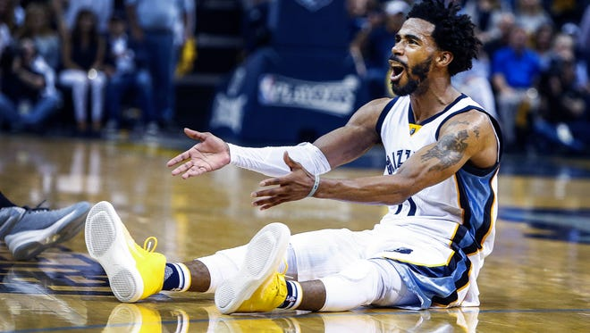 Memphis Grizzlies guard Mike Conley reacts to the officials non-foul call during fourth quarter action against the San Antonio Spurs in the sixth game of their NBA first round playoff series at the FedExForum on April 27, 2017.