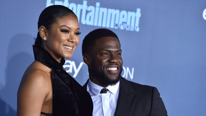 Kevin Hart, right, and Eniko Parrish arrive at the Critics' Choice Awards in Santa Monica on Dec. 11, 2016.