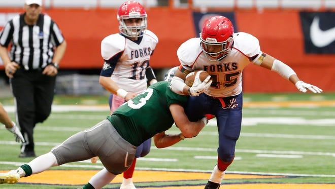 Chenango Forks' Jeremiah Allen is tackled by Pleasantville's Charlie McPhee during Sunday's New York State Class B championship in Syracuse on November 26, 2017.