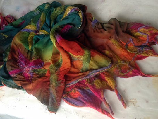 A fine silk piece by Linda Caperton full of bright