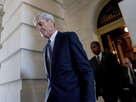 FILE - In this June 21, 2017, file photo, former FBI Director Robert Mueller, the special counsel probing Russian interference in the 2016 election, departs Capitol Hill following a closed door meeting in Washington. President Donald Trump is questioning the impartiality of Mueller's investigation and says the probe is groundless, while raising doubts about whether a fired top FBI official kept personal memos outlining his interactions with Trump. (AP Photo/Andrew Harnik, File)