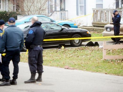 Investigators examine the scene of an officer-involved