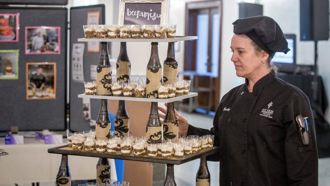 """Vendors scramble to dish out a food to a record breaking crowd at the 30th Annual A Taste of Muncie, """"Cheers to 30 Years"""" on Sunday at Cornerstone Center for the Arts."""