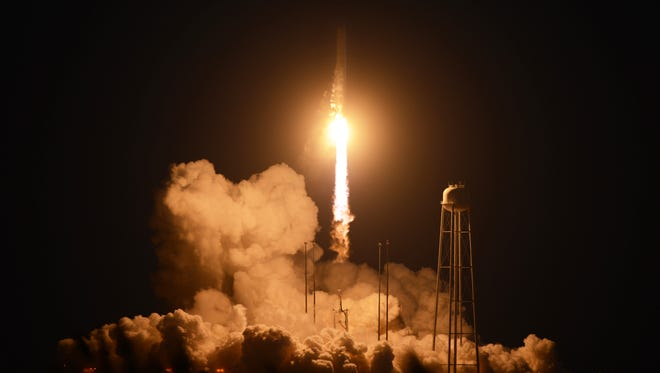 An unmanned Orbital Sciences Corp.'s Antares rocket headed for the International Space Station lifts off from the Wallops Flight Facility on Wallops Island, Va. on Tuesday, Oct. 28, 2014 shortly before exploding.