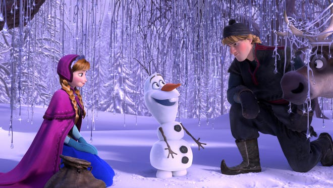 Anna (left, voiced by Kristen Bell), Olaf (Josh Gad) and Kristoff (Jonathan Groff) in 'Frozen.'