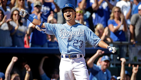 Nori Aoki reaches third on his two-run triple in the fourth inning Sunday.