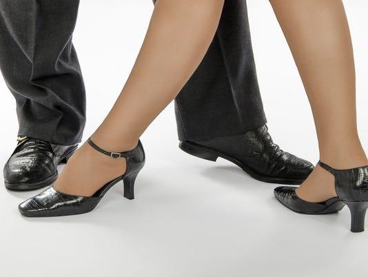 Couple legs standing in tango pose
