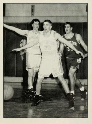 A photo of Bob Quinn playing basketball in the 1994 Norwood High yearbook.