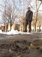 Burlington City Arborist Warren Spinner stands beside a muddy patch in City Hall Park on Wednesday. Photographed Dec. 7, 2016.