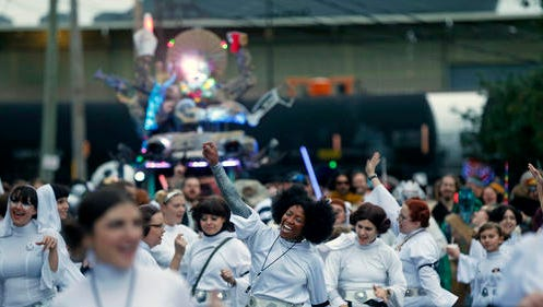 "Members of the Krewe of Chewbacchus, a Mardi Gras Krewe, hold a parade with members dressed as Princess Leia, in honor of actress Carrie Fisher, who played Leia in the ""Star Wars"" movie series, in New Orleans, Friday, Dec. 30, 2016. Fisher died on Dec. 27, 2016, at the age of 60."