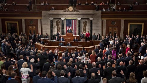 House Speaker Paul Ryan of Wisconsin, administers the House oath to the members of the House of Representatives as the 115th Congress convenes  on Capitol Hill in Washington, Tuesday.