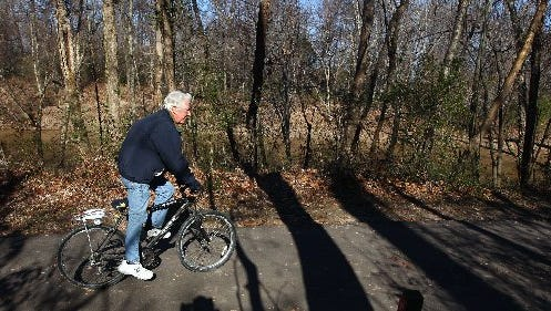 Michael Deming enjoys a bike ride along the Wolf River on the Germantown Greenway near Germantown Road.