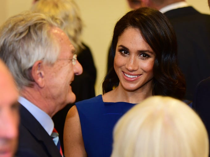 Duchess Meghan of Sussex chats with guests during the