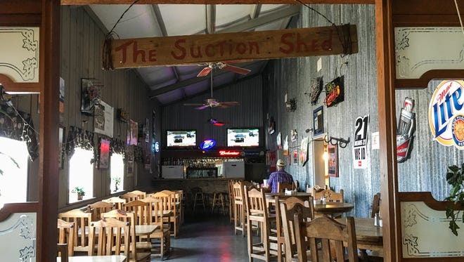 A single customer sits in the bar at Ole Gin Steakhouse in Wall as many people headed out-of-town to watch the Wall Hawks baseball team at the semi-finals game Wednesday, June 7.