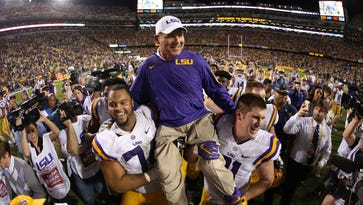 Les Miles left the field in the Tigers' final regular season game in style.