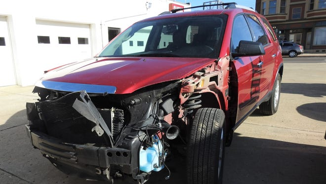 A GMC Acadia, involved in a deer accident recently, is being repaired at Classic Body Shop in Zanesville.