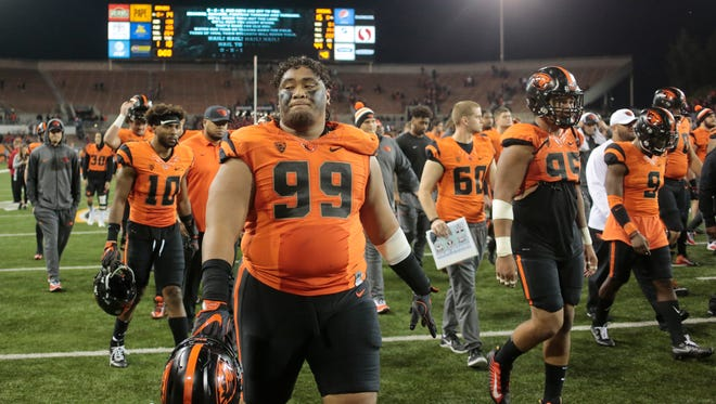 Oregon State nose tackle Elu Aydon (99) walks off the field after losing to Stanford 15-14 in an NCAA college football game, in Corvallis, Ore., Thursday, Oct. 26, 2017. (AP Photo/Timothy J. Gonzalez)