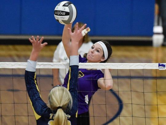Lexington's Lauren Slaton returns the ball Against