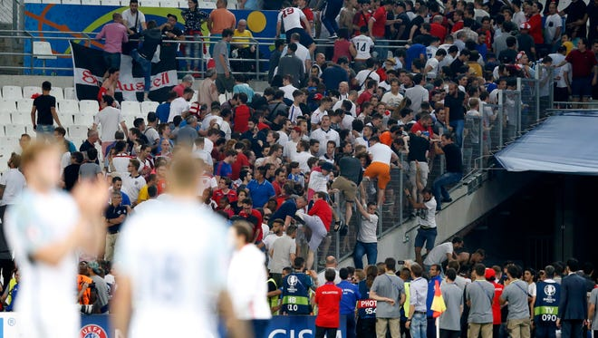 Spectators during clashes between Russian and England supporters after Saturday's match.