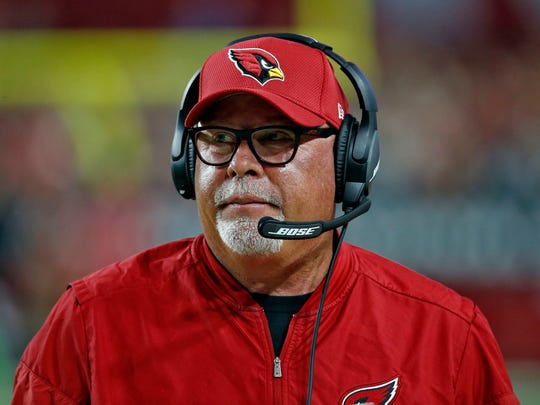 FILE - In this Nov. 26, 2017, file photo, Arizona Cardinals head coach Bruce Arians watches during the second half of an NFL football game against the Jacksonville Jaguars, in Glendale, Ariz. Arians is joining CBS as an NFL game analyst. Arians, a two-time winner of the AP's Coach of the Year award, retired as coach of the Arizona Cardinals in January. He will work with play-by-play announcer Greg Gumbel and analyst Trent Green in a three-man booth.(AP Photo/Ross D. Franklin, File)