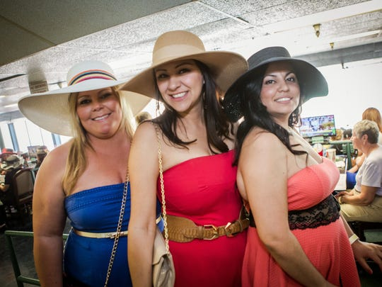 These ladies looked great in strapless dresses at Turf Paradise's Kentucky Derby party in Phoenix on Saturday, May 2, 2015.