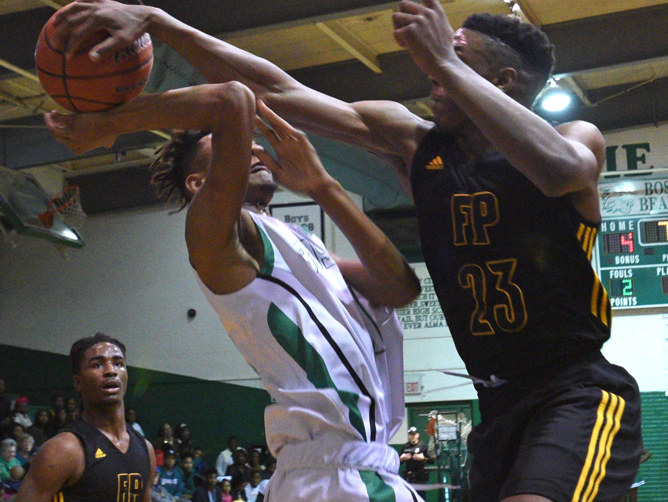 Fair Park's Latreavin Black blocks a shot against Bossier at the Bossier Invitational boys basketball tournament championship game.