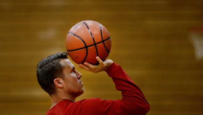 Former IU basketball player Jordan Hulls guides camp participants on warmup shooting technique during the 3rd annual JH1 Skills Academy Basketball Camp in Bloomington on June 22.